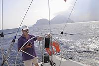 - sailing boat in navigation near the Tavolara island (Sardinia)....- barca a vela in navigazione presso l'isola di tavolara (Sardegna)