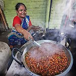 A woman cooks in a roadside cafe in Suihari in northern Bangladesh.