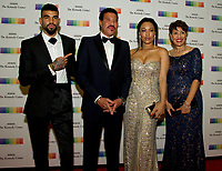 Lionel Richie, second left, arrives with son Miles, left, and girlfriend Lisa Parigi, second right, and sister Deborah Richie, right, for the formal Artist's Dinner honoring the recipients of the 40th Annual Kennedy Center Honors hosted by United States Secretary of State Rex Tillerson at the US Department of State in Washington, D.C. on Saturday, December 2, 2017. The 2017 honorees are: American dancer and choreographer Carmen de Lavallade; Cuban American singer-songwriter and actress Gloria Estefan; American hip hop artist and entertainment icon LL COOL J; American television writer and producer Norman Lear; and American musician and record producer Lionel Richie. Photo Credit: Ron Sachs/CNP/AdMedia
