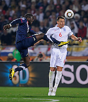 Jozy Altidore (left) of USA against John Terry (6) of England.. USA vs England in the 2010 FIFA World Cup in Rustenburg, South Africa on June 12, 2010.