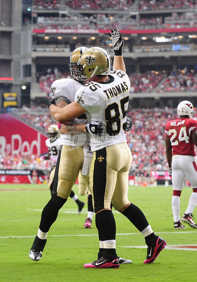 Oct. 10, 2010; Glendale, AZ, USA; New Orleans Saints tight end (88) Jeremy Shockey is congratulated by teammate (85) David Thomas after a touchdown against the Arizona Cardinals at University of Phoenix Stadium. The Cardinals defeated the Saints 30-20. Mandatory Credit: Mark J. Rebilas-
