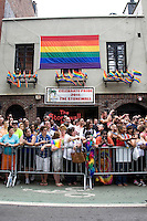 Crowds watch the 2011 NYC Pride March outside the historic Stonewall Inn on 26 June 2011 in New York, New York, two days after the New York State Senate voted 33-29 to legalize gay marriage.