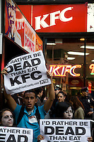 peta2, the youth division of People for the Ethical Treatment of Animals (PETA), leads a protest outside Kentucky Fried Chicken (KFC) while dressed as zombies.  The group is angry about KFC suppliers' abusive treatment of chickens on factory farms and in slaughterhouses.