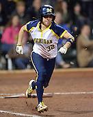 Michigan Wolverines Softball shortstop Sierra Romero (32) runs to first during a game against the University of South Florida Bulls on February 8, 2014 at the USF Softball Stadium in Tampa, Florida.  Michigan defeated USF 3-2.  (Copyright Mike Janes Photography)