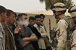 1st Lieutenant William Baynes resolves an issue with a bitter Iraqi man. Baynes is 2nd Platoon Leader for Company B, 5th Battalion, 20th Infantry Regiment, 3rd Brigade, 2nd Infantry Division. Photo by Sgt. Fred Minnick, 139 Mobile Public Affairs Detachment, TFO PAO...