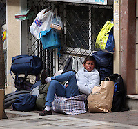 Pictured: A man rests in Heyden Street, Victoria Square Tuesday 08 March 2016<br /> Re: Migrants at Victoria Square, in central Athens, Greece.