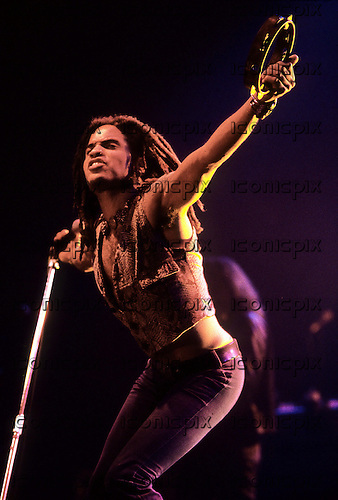 Lenny Kravitz - performing live on the There Is Only One Truth Tour at Wembley Arena in London UK - 24 Nov 1991.  Photo credit: George Chin/IconicPix