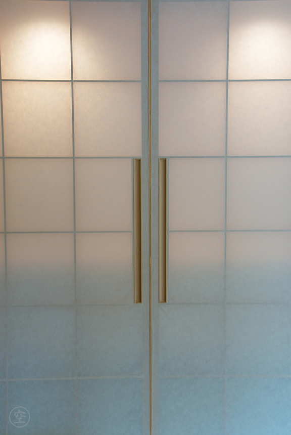 Sliding shoji (Japanese paper) doors, are back-lit by lights.