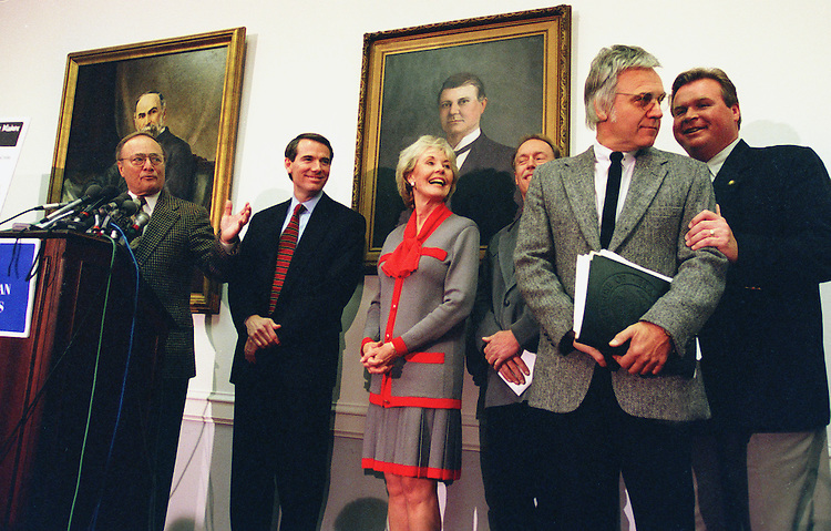 11/05/97.IRS REFORM--Ohio Democrat James A. Traficant, right front, is congratulated by Republicans for joining them in their effort to reform the IRS. From left to right are House Ways & Means Chairman Bill Archer, Rob Portman, R-Ohio, Jennifer Dunn, R-Wash., Bob Brockamp of Prescott, Ariz., who battled the IRS after his grandfather died, and J.D. Hayworth, R-Ariz..CONGRESSIONAL QUARTERLY PHOTO BY SCOTT J. FERRELL