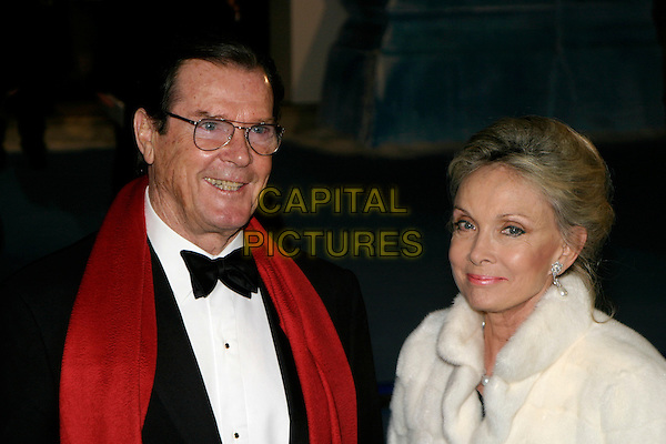 "ROGER MOORE & CHRISTINA THOLSTROP.""The Chronicles of Narnia: The Lion, The Witch & The Wardrobe"" - world premiere at the Royal Albert Hall, London, UK..December 7th, 2005.Ref: AH.headshot portrait bow tie red scarf glasses.www.capitalpictures.com.sales@capitalpictures.com.©Capital Pictures"
