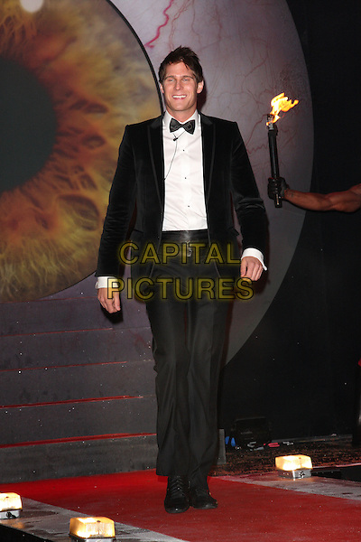 DJ BASSHUNTER aka Jonas Erik Altberg.Contestants enter the House on the Opening Night of Celebrity Big Brother, Elstree Studios, London, England, UK, .January 3rd 2010.CBB BB full length black suit bow tie tuxedo tux .CAP/ROS.©Steve Ross/Capital Pictures