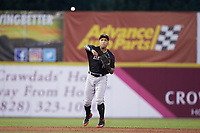 Kannapolis Intimidators shortstop Luis Curbelo (16) makes a throw to first base against the Hickory Crawdads at L.P. Frans Stadium on July 20, 2018 in Hickory, North Carolina. The Crawdads defeated the Intimidators 4-1. (Brian Westerholt/Four Seam Images)