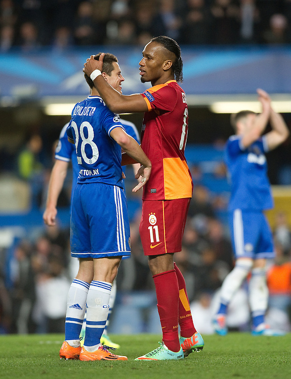 Galatasaray's Didier Drogba Chelsea's Cesar Azpilicueta at the end of the match<br /> <br /> Photo by Ashley Western/CameraSport<br /> <br /> Football - UEFA Champions League First Knockout Round 2nd Leg - Chelsea v Galatasaray - Tuesday 18th March 2014 - Stamford Bridge - London<br />  <br /> &copy; CameraSport - 43 Linden Ave. Countesthorpe. Leicester. England. LE8 5PG - Tel: +44 (0) 116 277 4147 - admin@camerasport.com - www.camerasport.com