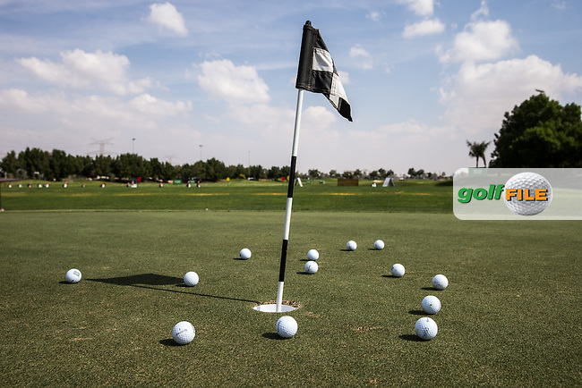 Practice putting area, The Track at The Meydan Golf Club, Dubai, United Arab Emirates.  31/01/2016. Picture: Golffile | David Lloyd<br /> <br /> All photos usage must carry mandatory copyright credit (&copy; Golffile | David Lloyd)