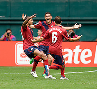 Jermaine Jones (13) of the USMNT celebrates his goal with Steve Cherundolo (6) and Eric Lichaj (14) during the game at RFK Stadium in Washington, DC.  The USMNT defeated Jamaica, 2-0.
