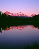 ORCAC_109 - USA, Oregon, Willamette National Forest, Sunset reddens the Three Sisters (left to right: North, Middle and South Sister) which reflect in Scott Lake.