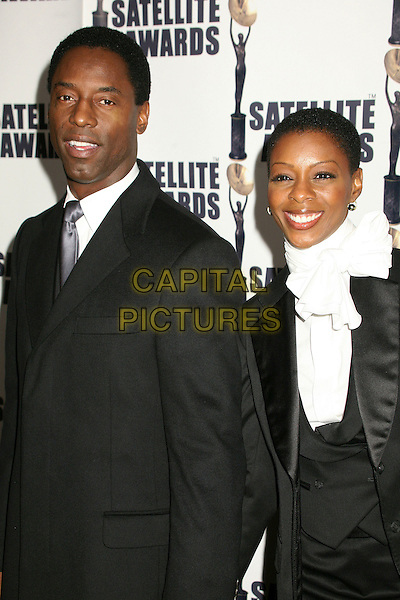ISAIAH WASHINGTON & JENISA WASHINGTON.11th Annual Satellite Awards by the International Press Academy at Le Méridian, Beverly Hills, California, USA.December 17th, 2006.half length black suit jacket white husband wife married .CAP/ADM/BP.©Byron Purvis/AdMedia/Capital Pictures