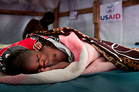 Nyayiel Puot rests on her first day of life in the maternity ward of the United Nation's Protection of Civilians camp in Juba, South Sudan. The international Medical Corps with funding from USAID runs a clinic, emergency room, maternity ward and hospital in the camp where 83 children were born in August.