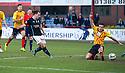 Dundee's Paul McGowan scores their late winning goal.