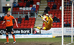 Dundee Utd keeper Radoslaw Cierzniak tips the ball onto the post from  Steven MacLean's header
