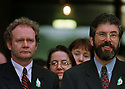 Sinn Fein's chief negotiator Martin Mcguinness, left, and the Sinn Fein President Gerry Adams, right,  comment on the settlement of the Northern Ireland peace talks  at the Stormont Castle Buildings in Belfast Friday, April 10, 1998.    (AP Photo/ Paul McErlane)