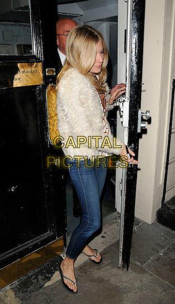 "SIENNA MILLER .Departed after the evening performance of ""Flare Path"", Theatre Royal Haymarket, London, England, UK, .11th April 2011..full length jeans flip flops white fluffy jacket cream .CAP/CAN.©Can Nguyen/Capital Pictures."