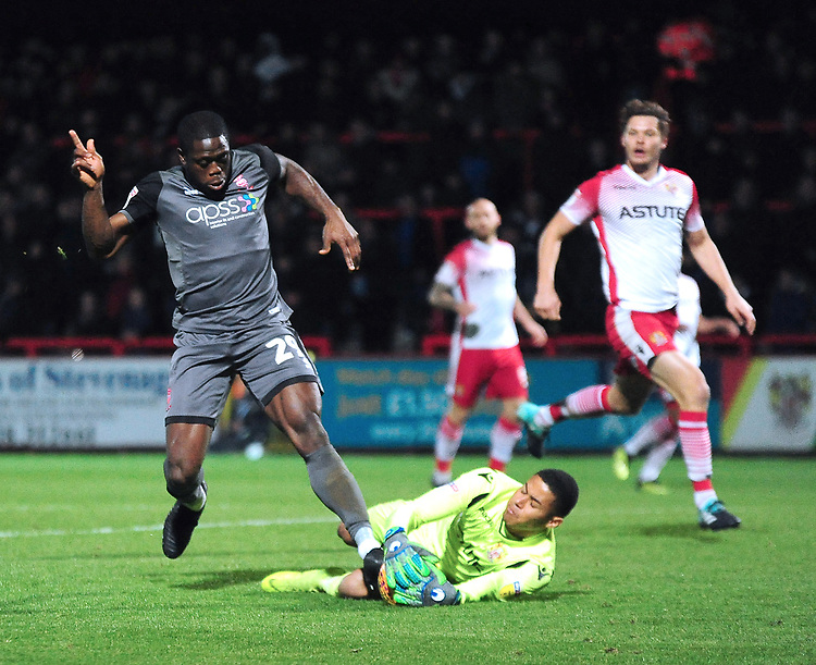 Stevenage's Seny Dieng saves at the feet of Lincoln City's John Akinde<br /> <br /> Photographer Andrew Vaughan/CameraSport<br /> <br /> The EFL Sky Bet League Two - Stevenage v Lincoln City - Saturday 8th December 2018 - The Lamex Stadium - Stevenage<br /> <br /> World Copyright © 2018 CameraSport. All rights reserved. 43 Linden Ave. Countesthorpe. Leicester. England. LE8 5PG - Tel: +44 (0) 116 277 4147 - admin@camerasport.com - www.camerasport.com