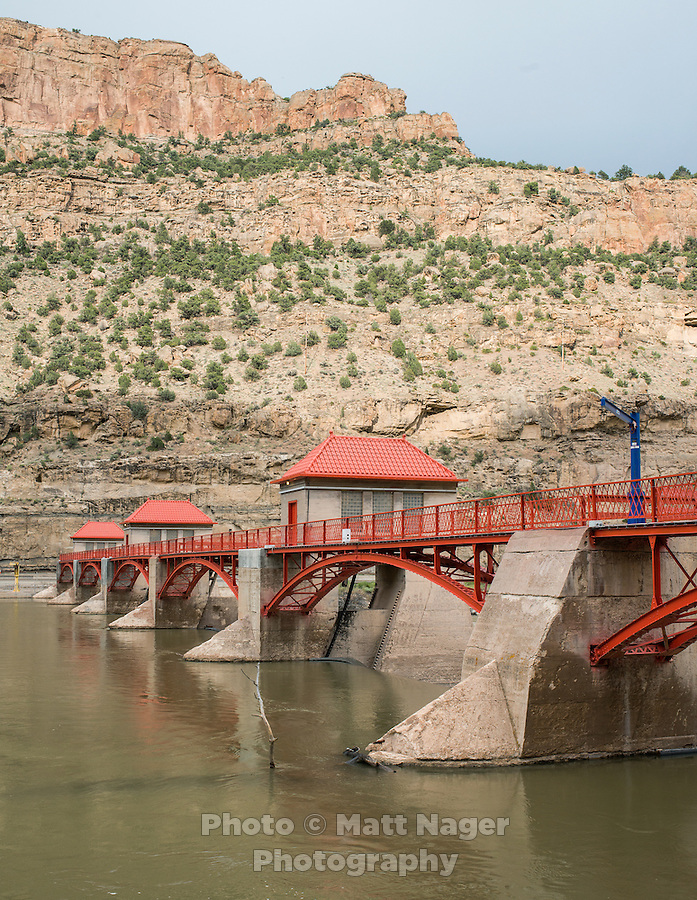 The Grand Valley Diversion Dam along the Colorado River near Grand Junction, Colorado, Sunday, July 5, 2015. The dam is a 14-foot (4.3 m) high, 546-foot (166 m) long concrete roller dam with six gates, which were the first and largest of their kind to be installed in the United States. The dam is primarily used for irrigation for the Grand Valley. <br /> <br /> Photo by Matt Nager