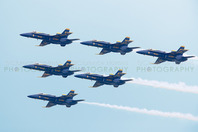 The US Navy Blue Angels perform a flyover over the Hudson River during the Parade of Ships, part of OpSail 2012 at the start of Fleet Week in New York City.