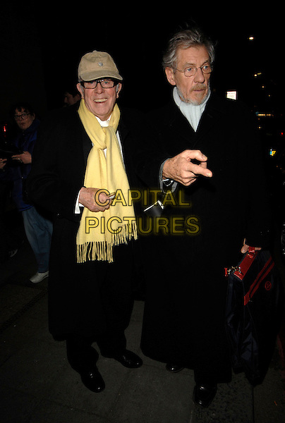 SIR IAN McKELLEN.Arrivals - Laurence Olivier Awards at the Grosvenor Hotel, Park Lane, London, UK..February 18th, 2007.full length black coat scarf yellow baseball cap hat.CAP/CAN.©Can Nguyen/Capital Pictures