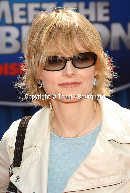 Jodie Foster arriving at the Meet The Robinsons Premiere at the El Capitan Theatre In Los Angeles. <br /> <br /> headshot<br /> eye contact<br /> sun glass