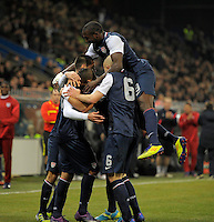 GENOVA, ITALY - February 29, 2012: Clint Dempsey (l, USA) celebrates his goal during the USA friendly match against Italy at the Stadium Luigi Ferraris in Genova, Italy.