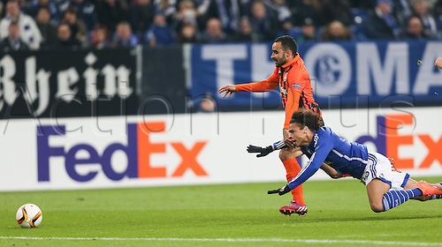 25.02.2016. Gelsenkirchen, Germany.  Schalke's Leroy San and Donetsk's Ismaily Goncalves dos Santos in action during the Europa League Round of 32 Second Leg soccer match between FC Schalke 04 and FC Shakhtar Donetsk in the Veltins Arena in Gelsenkirchen, Germany, 25 February 2016.