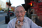 Herman Holmes smiles while he points down main street toward where the old movie theater used to be. Photo by Alex Holt