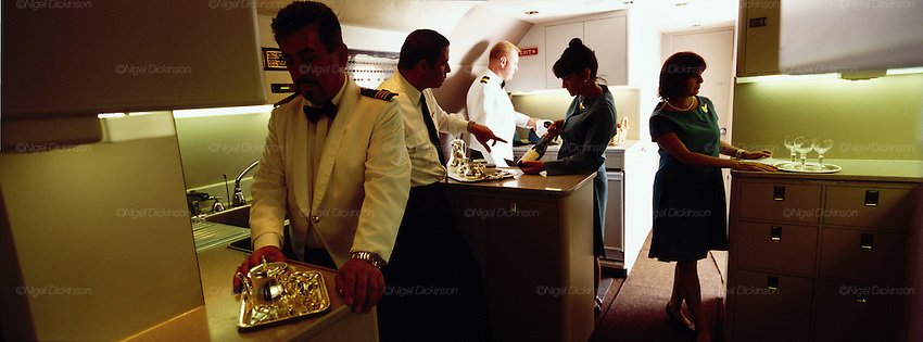 "John Travolta, captain and pilot, of his own jumbo jet, involved with his cabin crew, serving and preparing hospitality for his guests...John Travolta is pilot of his very own jumbo jet, a 1964 Boeing 707-100 series. In 2003, John Travolta flew his jumbo jet around the world, in partnership with Quantas, to rekindle confidence in commercial aviation, and to remind us that elegance and style are a part of flying. The crew are dressed in tailor made authentic uniforms from the Quantas museum. The men's uniforms are styled on British Naval uniforms and the ladies' designed by Chanel. His jumbo jet sports a personalised number plate N707JT which speaks for itself. The aircraft is named ""Jett Clipper Ella"" dedicated to his son and daughter. This jumbo together with his other aircraft are housed in purpose built hangars at his home in Florida, USA."