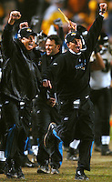 Jacksonville Jaguars head coach Jack Del Rio (left) and quarterbacks coach Mike Shula cheer as the Jags defense recovered a fumble by Pittsburgh Steelers quarterback Ben Roethlisberger with under a minute to play to seal the Jags 31-29 victory at Heinz Field in Pittsburgh, Pa.  (The Florida Times-Union, Rick Wilson)