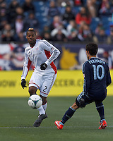 New England Revolution defender Andrew Farrell (2) clears the ball.   In a Major League Soccer (MLS) match, Sporting Kansas City (blue) tied the New England Revolution (white), 0-0, at Gillette Stadium on March 23, 2013.