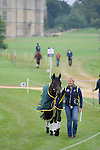 Australian groom Alex VanTuyll leading a horse during the Dressage phase of the 2014 Land Rover Burghley Horse Trials held at Burghley House, Stamford, Lincolnshire