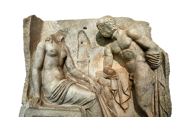 "Close up of a Roman Sebasteion relief  sculpture of Io and Argos Aphrodisias Museum, Aphrodisias, Turkey.     Against a white background.<br /> <br /> A powerful hero is folding a sword gazing closely at a half naked and dishevelled young heroine who sits on a chest like stool. Between, on a pillar base stood a small, separately added statue of a goddess ( now missing). The scene follows a scheme used in the relief panels ""Io guarded by Argos"". Io was one of Zeus's lovers, and Argos was a watchful giant sent to guard her by Hera, Zeus's wife."
