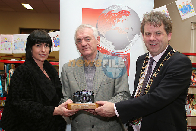 Des Clinton with his award for Advanced Projected Image Photography, presented by Elaine Grennan of Beverage Business Solutions and Mayor Michael O'Dowd at the Launch of the Drogheda Photographic Club's Annual Exhibition in Drogheda Library, Stockwell Street...Photo NEWSFILE/Jenny Matthews.(Photo credit should read Jenny Matthews/NEWSFILE)....This Picture has been sent you under the condtions enclosed by:.Newsfile Ltd..The Studio,.Millmount Abbey,.Drogheda,.Co Meath..Ireland..Tel: +353(0)41-9871240.Fax: +353(0)41-9871260.GSM: +353(0)86-2500958.email: pictures@newsfile.ie.www.newsfile.ie.FTP: 193.120.102.198.