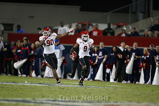 Trent Nelson  |  The Salt Lake Tribune.Utah's Conroy Black runs back an interception during the second half as Utah faces Arizona, college football at Arizona Stadium in Tucson, Arizona, Saturday, November 5, 2011. Utah's Derrick Shelby at left.