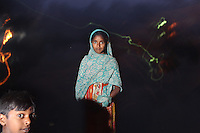 A young Indian girl in the village of Sangrampur which collects e-Waste from nearby Kolkata, India. November, 2013