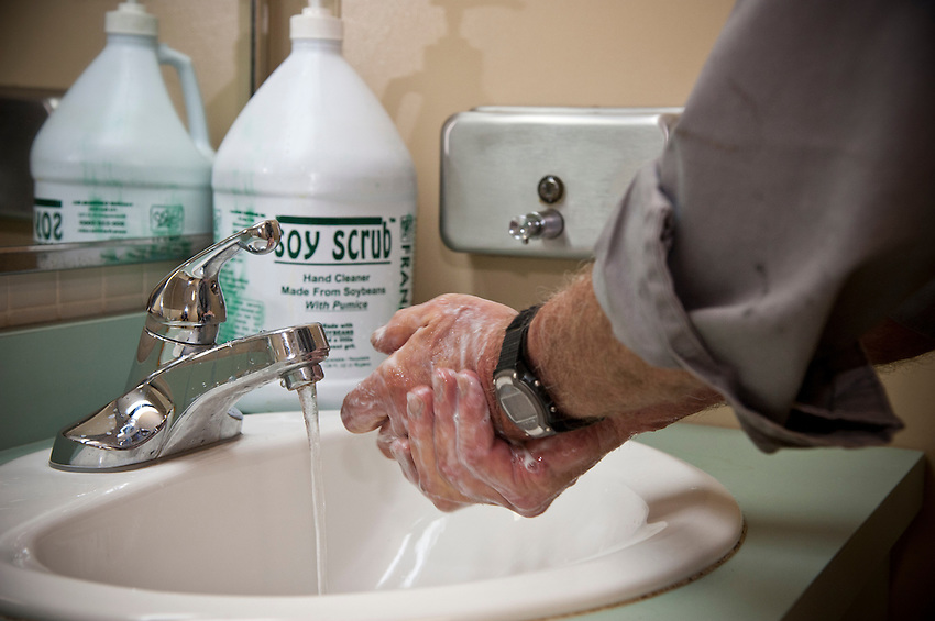 Pictured Rocks National Lakeshore employee William Magli washes grease from his hands with a soy-based cleaner.