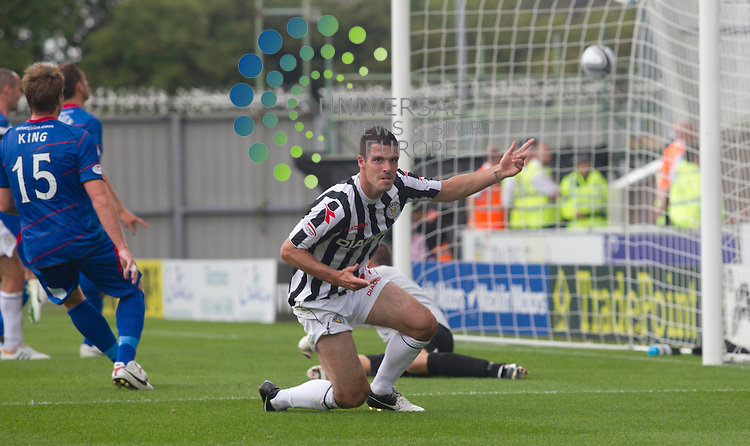 Lewis Guy scores for St mirren past keeper Ryan Esson during the St Mirren v inverness  at St mirren Park.Picture: Maurice McDonald/Universal News And Sport (Europe). 4 August  2012. www.unpixs.com.