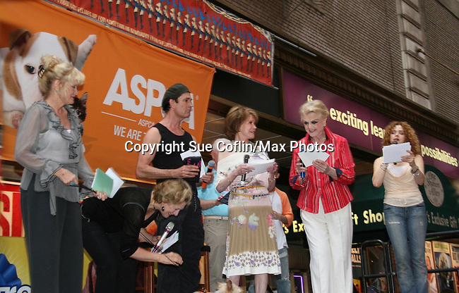 """Christine Ebersole, Jayne Atkinson, Rupert Evert with Angela Lansbury on stage with Mary Tyler Moore and Bernadette Peters at Broadway Barks 11 - a """"Pawpular"""" star-studded dog and cat adopt-a-thon on July 11, 2009 in Shubert Alley, New York City, NY. (Photo by Sue Coflin/Max Photos)"""