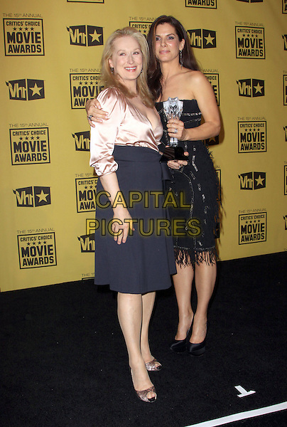 MERYL STREEP & SANDRA BULLOCK .15th Annual Critics' Choice Movie Awards Press Room held The Hollywood Palladium, Hollywood, California, USA, 15th January 2010..press room pressroom  full length black strapless award winner trophy beaded dress fringed tassels shoes lace peep toe peach pink satin blouse shirt blue dress wrap Christian Louboutin arm around .CAP/ADM/KB.©Kevan Brooks/Admedia/Capital Pictures