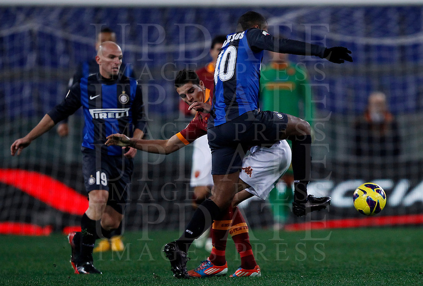 Calcio, semifinale di andata di Coppa Italia: Roma vs Inter. Roma, stadio Olimpico, 23 gennaio 2013..FC Inter defender Juan Jesus, of Brazil, right, and AS Roma forward Erik Lamela, of Argentina, center, fight for the ball during the Italy Cup football semifinal first half match between AS Roma and FC Inter at Rome's Olympic stadium, 23 January 2013..UPDATE IMAGES PRESS/Isabella Bonotto