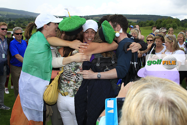 Maria Dunne,celebrates the win with her family after the Sunday Singles matches at the 2016 Curtis cup from Dun Laoghaire Golf Club, Ballyman Rd, Enniskerry, Co. Wicklow, Ireland. 12/06/2016.<br /> Picture Fran Caffrey / Golffile.ie<br /> <br /> All photo usage must carry mandatory copyright credit (&copy; Golffile | Fran Caffrey)