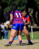 Siana Vagana (Richmond) runs at Mia Holo during the Auckland Rugby League Girls Pilot under-17 match between Otara Scorpions and Richmond at Ngati Otara Park in Auckland, New Zealand on Saturday, 9 June 2018. Photo: Dave Lintott / lintottphoto.co.nz