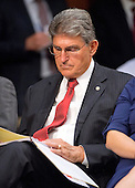 """United States Senator Joe Manchin (Democrat of West Virginia), follows the U.S. Senate Foreign Relations Committee hearing on """"Authorization of Use of Force in Syria""""  on Capitol Hill in Washington, D.C. on Tuesday, September 3, 2013.  Sen. Manchin is not a member of the Foreign Relations Committee.<br /> Credit: Ron Sachs / CNP"""